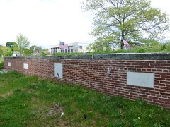 Brick wall with grave markers
