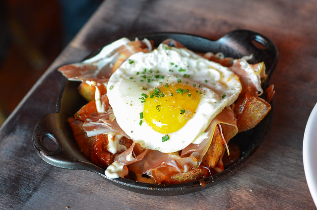 bravas trencades fried potatoes, serrano ham, chorizo, fried egg