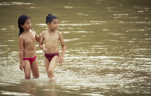 boy sunset girl swim river children bath laos lao luangprabang luang prabang