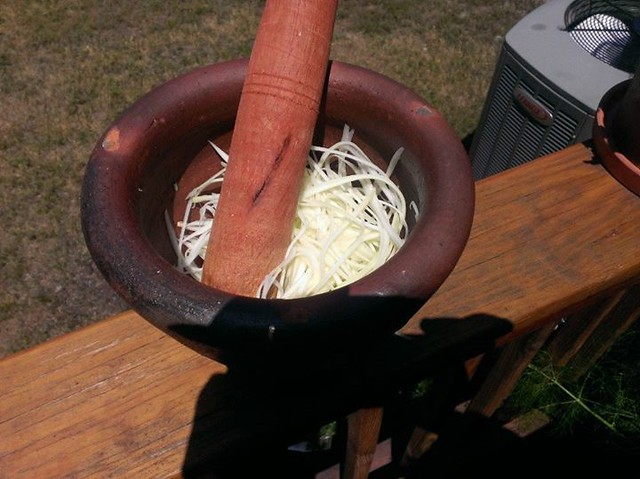 Shredded green papaya in mortar