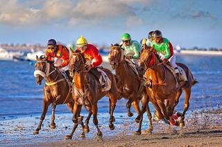 Carreras de caballos en la playa de Sanlúcar de Barrameda.