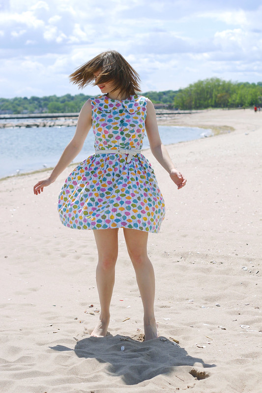 twirl on the beach, twirling, girl twirling, girl twirling on the beach, spinning, shell dress
