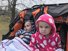 The twins have fascinating expressions as they enjoy our walk in town today