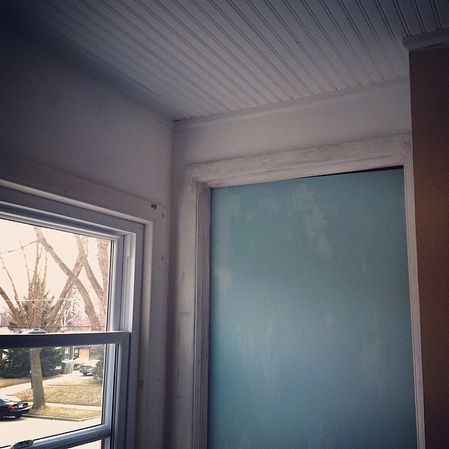 Finally painting the upstairs hallway. That blue door blows my mind.