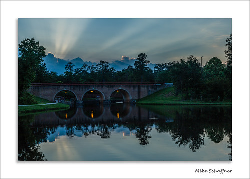 bridge trees sunset lake reflection water clouds evening spring pond texas arch unitedstates dusk rays nightfall thewoodlands crepescularrays crepescular aldenbridge