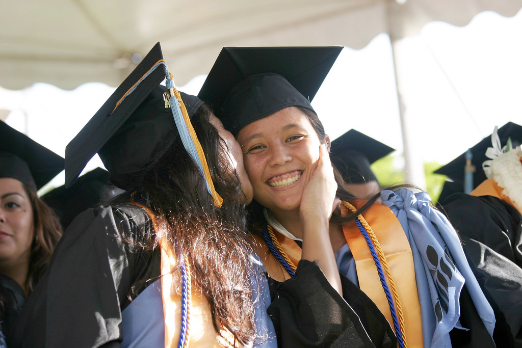 """<p>Victoria Quiniola, right, introduced as the student speaker surprising her mom, left, who graduated with her at Leeward's commencement ceremony at Tuthill Courtyard on May, 16, 2014. For more photos go to <a href=""""https://www.flickr.com/photos/leewardcc/sets/72157644342097098/"""">www.flickr.com/photos/leewardcc/sets/72157644342097098/</a></p>"""