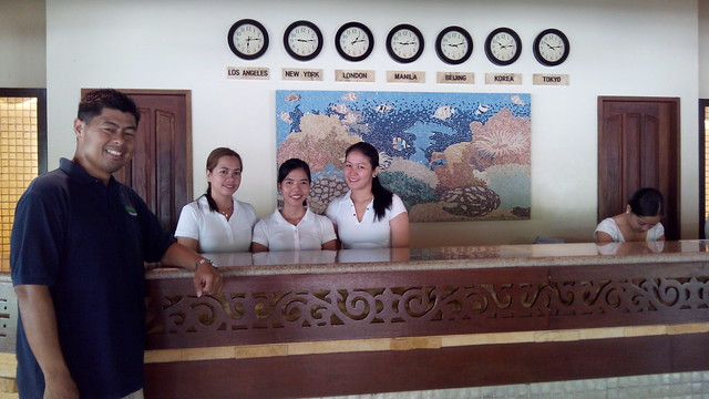 CAPTURED BY KATA M1. Smiling desk officers and Bohol Beach Club manager.