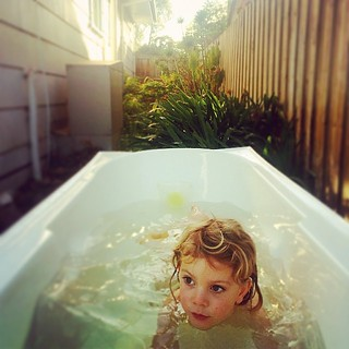 365/157 • bathing in a backyard - it is SO cold this morning • #2014_ig_157 #3yo #sundaymorning