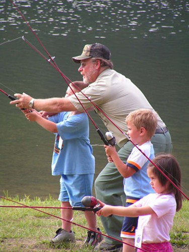 A U.S. Forest Service employee teaches kids how to cast fishing rods on the Hoosier National Forest in Indiana. (U.S. Forest Service)