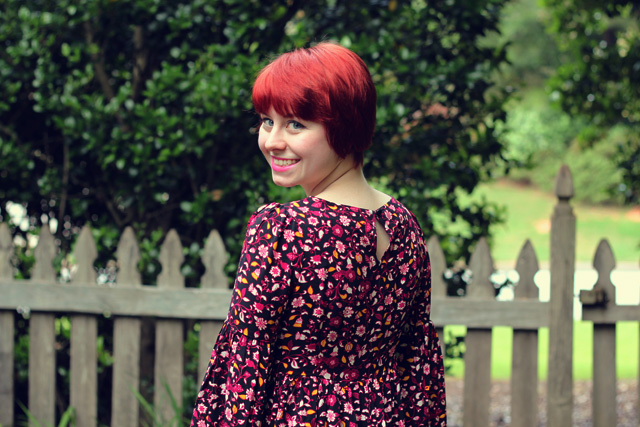 Floral Print Retro Dress with a Red Pixie Cut