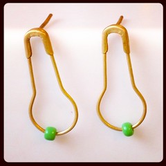 Today I've accessorised my gold plated safety pin earrings with teeny green glass beads from Marrakech. I started making more pairs yesterday.
