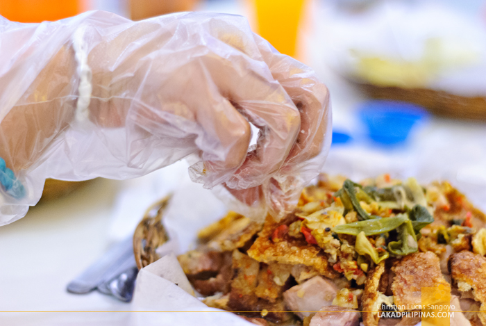 Eating with Bare Hands at Cebu's Original Lechon Belly