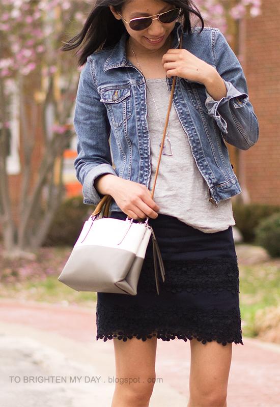 denim jacket, gray tee, navy lace skirt, striped crossbody bag