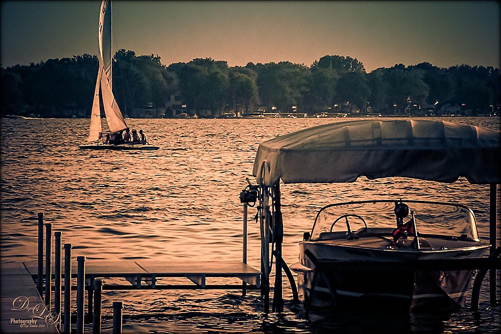 Image taken at Lake Wawasee, Indiana, of sailboat and wood boat