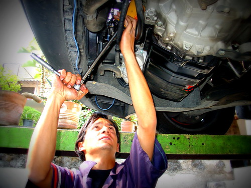 Auto mechanic in action