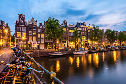 street bridge houses sky holland netherlands colors amsterdam night clouds reflections lights canal cloudy singel