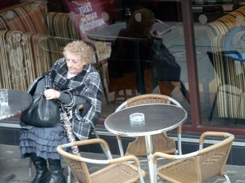 Old lady in a cafe