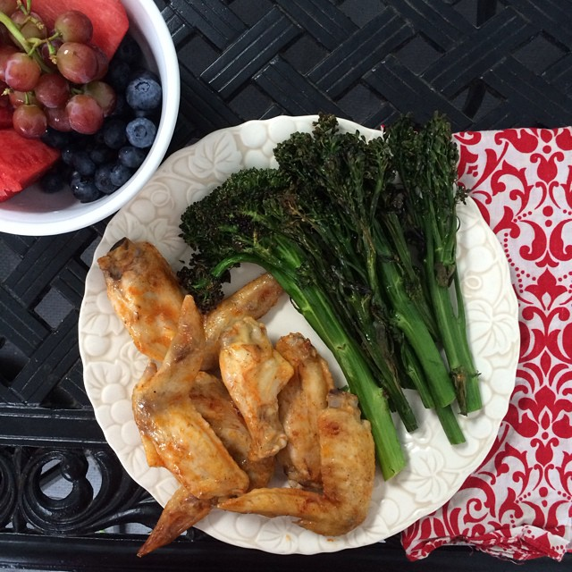 Day 19, #whole30 - dinner (hot wings, roasted broccolini, fruit bowl)