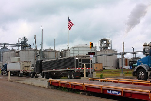 Trucks line-up to cross the scales at Coshocton, Ohio's Three Rivers Energy biofuels plant. A $9 million loan guarantee through USDA's Rural Energy for America Program is helping renovate and improve operations at the facility, which employs about 40 rural Ohioans and is expected to use an estimated 16 million bushels of primarily locally-harvested corn each year. (USDA photo: Heather Hartley)
