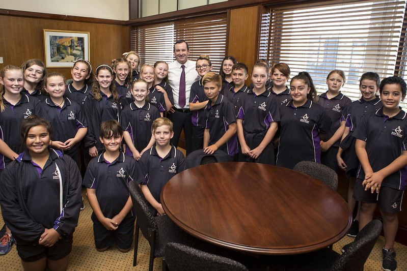 students from John Butler Primary College pose for a photo with Premier elect Mark McGowan today. Pic: Michael Wilson The West Australian