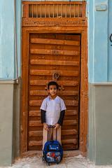 schoolboy in doorway - Shibam, Yemen