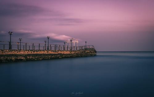 jetty longexposure twilight dawn pier seascape sky sea sunset smooth blue water cyprus sony sonya6000 ilce6000 sigma sigma30mmf14dcdn haidafilter manfrottobefree
