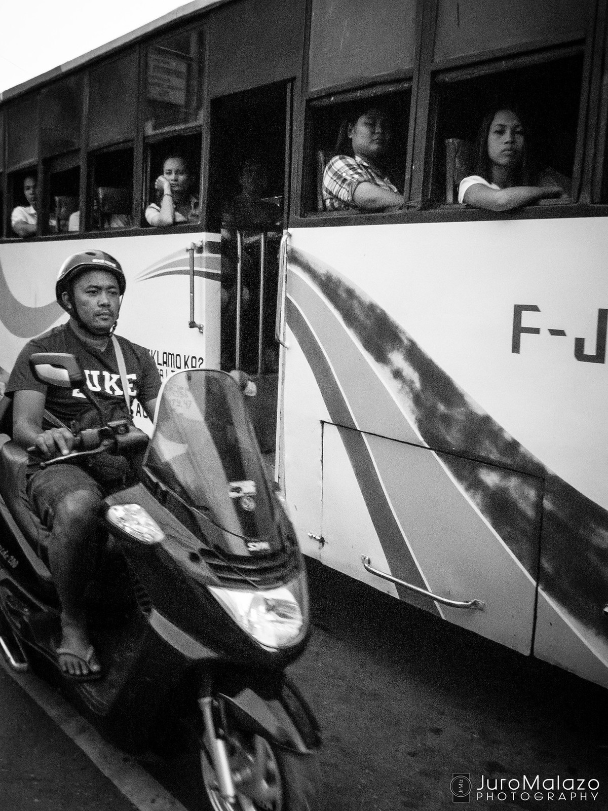 Ride the Waves. (Out on the Streets: Street Photography by Juro Malazo)