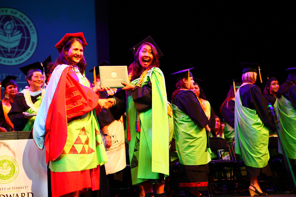 """<p>Kayleen Sur, ASUH-Windward CC student government president, receiving her diploma at Windward CC's commencement ceremony at the Paliku Theatre on May 17, 2014. Photo by Bonnie Beatson<br /> <br /> For more photos go to <a href=""""https://www.facebook.com/buddy.aloha/media_set?set=a.597700886995993.1073741831.100002682609200"""" rel=""""nofollow"""">www.facebook.com/buddy.aloha/media_set?set=a.597700886995...</a></p>"""