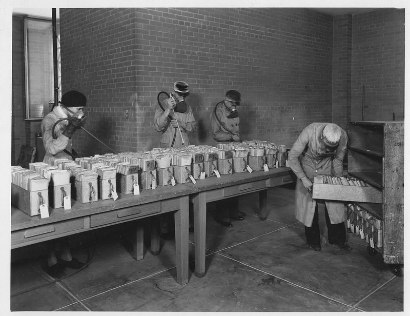 Photograph of Workers Dusting Veteran's Bureau Records, 06/12/1936
