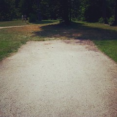 The road ended in the park... You can't step on grass... But there is another path some steps away: what's the logic?