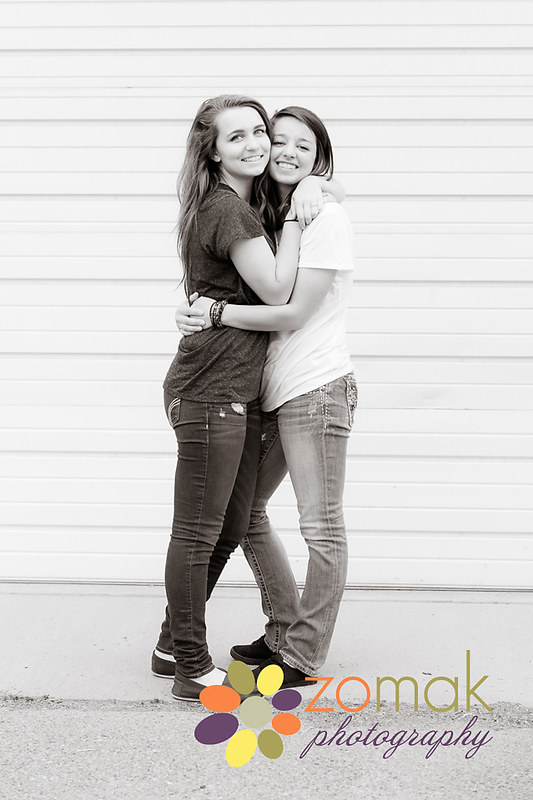 Best friends give a big hug for their senior photo session