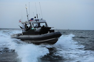 POHANG, South Korea- A boat crew from U.S. Coast Guard Port Security Unit (PSU) 313, from Everett, Wash., conducts a security patrol in a 4th generation, 32-foot transportable security boat (TSB) off the coast of Dogu beach in support of exercise Foal Eagle, April 21, 2013. Exercise Foal Eagle, as a bi-annual combined and joint unit tactical field training exercise, provides valuable military training based on realistic requirements and missions expected of the Republic of Korea and U.S. forces on the Korean Peninsula. (U.S. Coast Guard photo by Petty Officer 2nd Class Etta Smith)