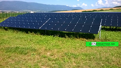 outdoor structure(0.0), solar panel(1.0), field(1.0), solar energy(1.0), solar power(1.0), grassland(1.0),