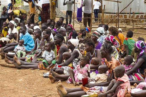 Women and children wait outside a nutrition centre