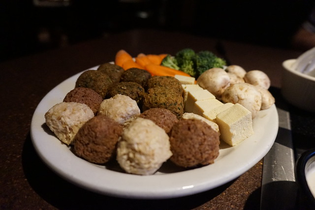 Close up of veggie meatballs, tofu, mushrooms, broccoli, carrots at UFondue