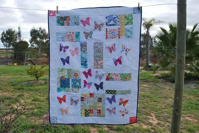My Kate Spain butterfly quilt. Made from our Kate Spain charm square swap.