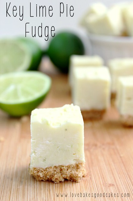 Key Lime Pie Fudge cut into squares with limes on a cutting board.