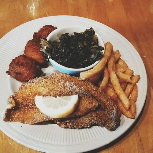 fried catfish, hush puppies, turnip greens, fries.