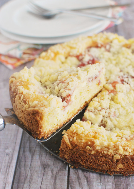 Strawberry Cream Cheese Coffee Cake - cake for breakfast! Coffee cake filled with strawberry cheesecake and topped with crumb topping!
