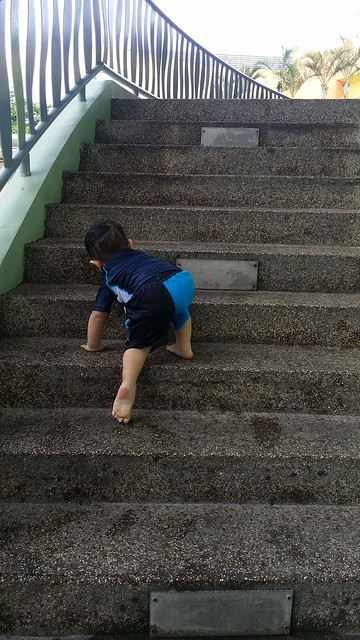 Jerome scaling the stairs at the swimming pool premises.
