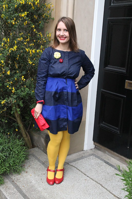 navy blue cos dress with yellow tights