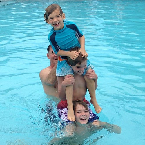 Finn and his cousins horse around in the pool