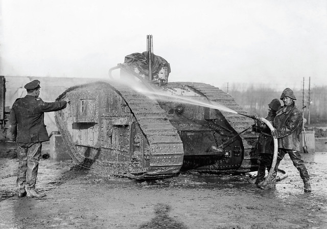 Chinese workers at a WWI tank servicing facility