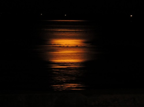 Moon rising lit water