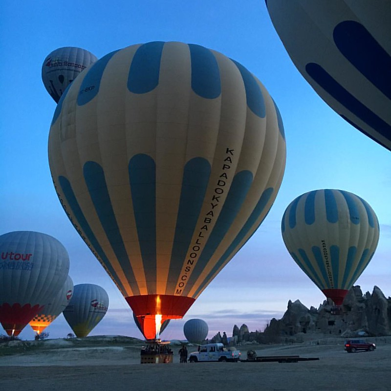 In the morning haze beneath the valley of cappadocia, I'm waiting with excitement for my first ever air ballon fly.