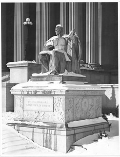 Photograph of the Male Statue, Eternal Vigilance, in the Snow near the Pennsylvania Entrance to the National Archives Building, 01/04/1936
