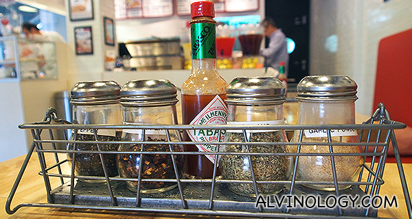 Condiments at each table for the pizzas