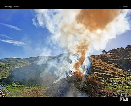 camera sky sun rural landscape fire smoke samsung bonfire hils nx tomraven aravenimage q22014
