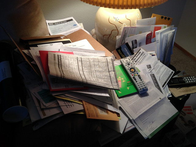 End table covered in junk mail