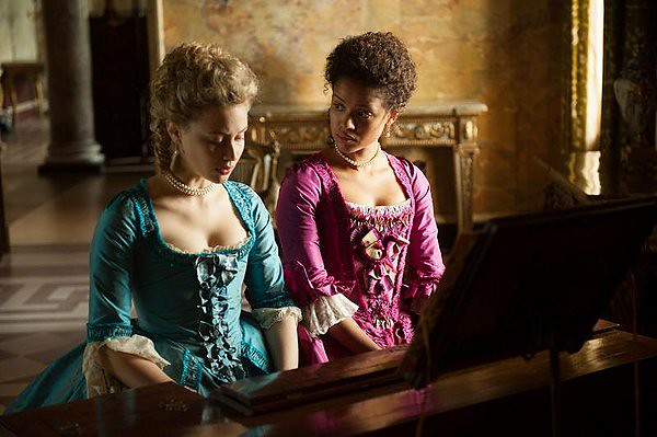 Gugu Mbatha-Raw (R) and Sarah Gadon demonstrate in 18th century England that love makes a family in BELLE.